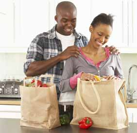 Couple in Kitchen with Groceries